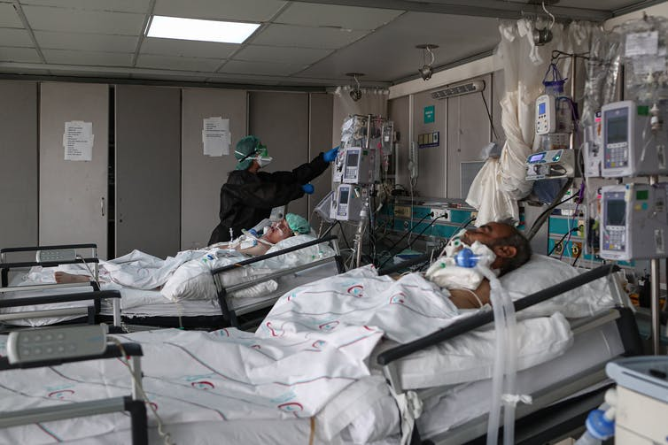 Two patients in an intensive care ward.