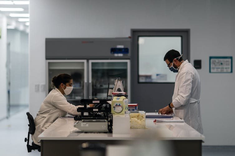 Two scientists in lab coats at mAbxience's Buenos Aires laboratory.