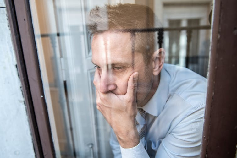 A man looking out of a window