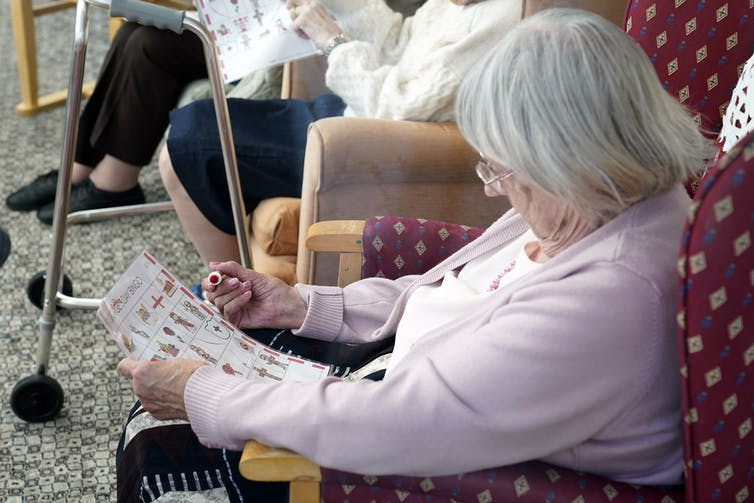 An elderly woman in a care home.