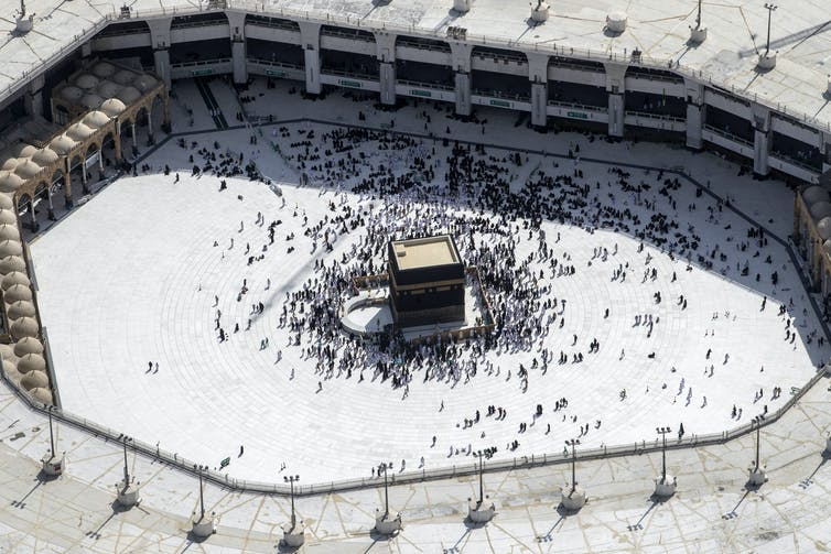 Muslim Hajj pilgrims at the Kaaba in Mecca, Saudi Arabia.