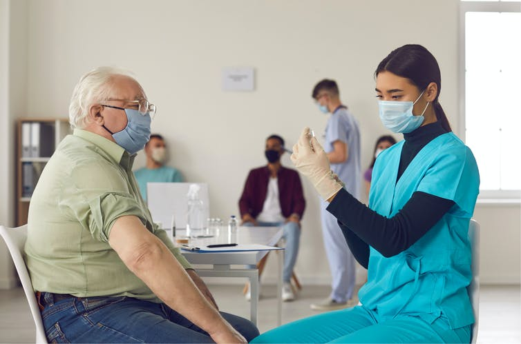 An older man getting vaccinated