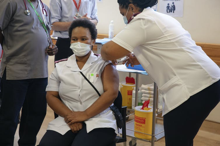 A health worker being vaccinated